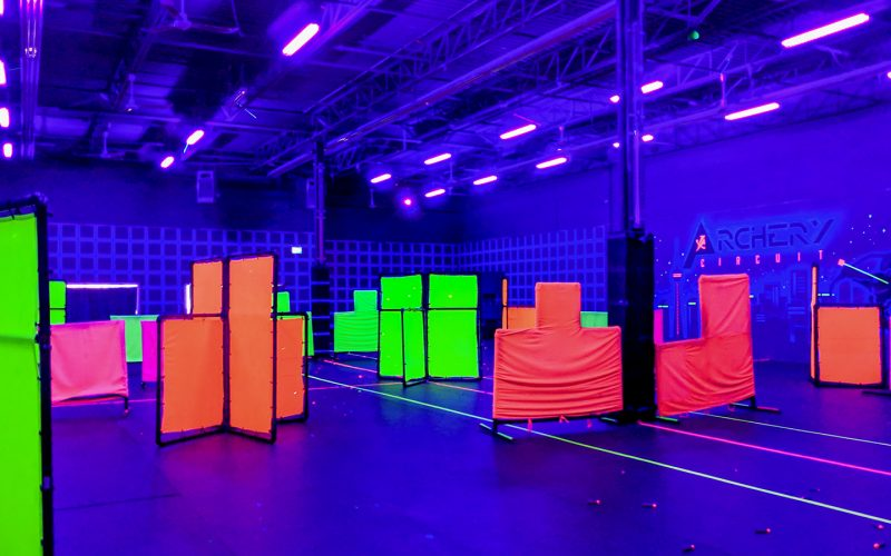 Archery Circuit arena, inside, blacklights on