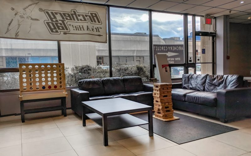 Lounge with couches and large mini-games for parents and guests to hang out